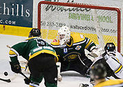 Victoria Grizzlies forward Dane Finnson gets a shot off as Kings goaltender Brian Wilson makes a right pad save at the Q Centre in Colwood, British Columbia Canada on March 27, 2017.