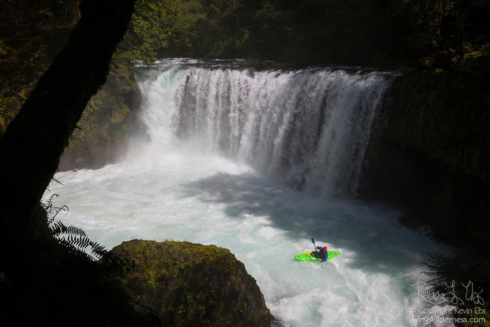 A kayaker prepares to go over the lower tier of Spirit Falls, located in Skamania County, Washington, moments after going over the 35-foot (10-meter) upper tier. The waterfall and the rapids below it are especially popular with kayakers. The Little White Salmon River is a tributary of the Columbia River.