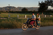 Young couple in a motorbike, in Inle Lake.<br /> Note: These images are not distributed or sold in Portugal