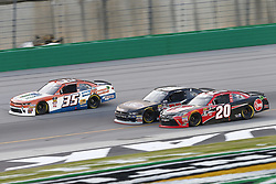 July 13, 2018 - Sparta, Kentucky, United States of America - Joey Gase (35), Ty Majeski (60) and Christopher Bell (20) battle for position during the Alsco 300 at Kentucky Speedway in Sparta, Kentucky. (Credit Image: © Chris Owens Asp Inc/ASP via ZUMA Wire)