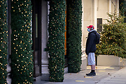 In advance of a re-opening of businesses and before a change to a Tier 2 for London during the second wave of the Coronavirus pandemic, a shopper looks at Christmas window displays outside Selfridges on Oxford Street, on 30th November 2020, in London, England. Retailers will once again be open for Christmas business on 3rd December.
