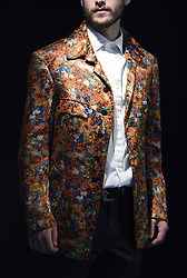 A staff member wears a silk jacket once worn by Keith Richards of the Rolling Stones on display ahead of the the Entertainment Memorabilia Sale at Bonhams in Knightsbridge, London later this week.