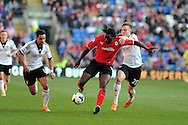 Cardiff city's Kenwyne Jones © holds off Fulham's Cauley Woodrow  (r). Barclays Premier league, Cardiff city v Fulham at the Cardiff city Stadium in Cardiff , South Wales on Sat 8th March 2014. pic by Andrew Orchard, Andrew Orchard sports photography