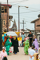 Outside the Jama Masjid Mosque, Srinagar, Kashmir, Jammu and Kashmir State, India. The mosque was built in 1394.