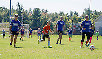Mitzi Tucker, Kaden Dolloff (orange shirt), Andrew Mercer and Andrea Besegai run down field during the Elm Street School Student / Faculty soccer match held Sunday morning at Robbie Mills Field.  (Karen Bobotas/for the Laconia Daily Sun)
