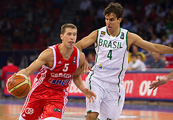 Davor Kus of Croatia vs Marcelo Machado of Brasil during  the Preliminary Round - Group B basketball match between National teams of Brasil and Croatia at 2010 FIBA World Championships on September 2, 2010 at Abdi Ipekci Arena in Istanbul, Turkey. (Photo By Vid Ponikvar / Sportida.com)