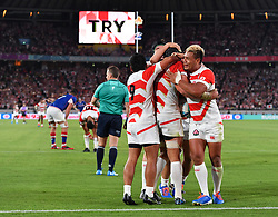 Japan's Pieter Labuschagne is congratulated by team mates after scoring their third try during the Pool A match between Japan and Russia at the Tokyo Stadium, Tokyo, Japan. Picture date: Friday September 20, 2019. See PA story RUGBYU Japan. Photo credit should read: Ashley Western/PA Wire. RESTRICTIONS: Editorial use only. Strictly no commercial use or association. Still image use only. Use implies acceptance of RWC 2019 T&Cs (in particular Section 5 of RWC 2019 T&Cs) at: https://bit.ly/2knOId6
