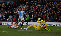 Blackburn Rovers' Joshua King scores his sides fourth goal and completes his hat trick shooting past Stoke City's goalkeeper Jack Butland<br /> <br /> Photographer Stephen White/CameraSport<br /> <br /> Football - The FA Cup Fifth Round - Blackburn Rovers v Stoke City - Saturday 14th February 2015 -  Ewood Park - Blackburn<br /> <br /> © CameraSport - 43 Linden Ave. Countesthorpe. Leicester. England. LE8 5PG - Tel: +44 (0) 116 277 4147 - admin@camerasport.com - www.camerasport.com