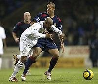 Fotball<br /> England 2004/2005<br /> Foto: SBI/Digitalsport<br /> NORWAY ONLY<br /> <br /> Bolton Wanderers v Portsmouth<br /> FA Barclays Premiership.<br /> 27/11/2004.<br /> <br /> Bolton's El Hadji Diouf and Pompey's Nigel Quashie