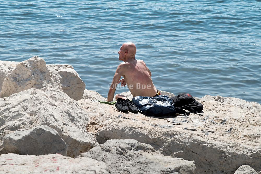 sun bathing Naples Italy