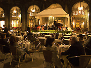 Band playing at night at the Florian restaurant  in St. Marks Square, Venice