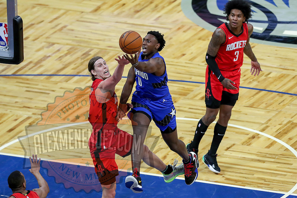 ORLANDO, FL - APRIL 18: Devin Cannady #30 of the Orlando Magic scores over Kelly Olynyk #41 of the Houston Rockets as Kevin Porter Jr. #3 of the Houston Rockets looks on during the first half at Amway Center on April 18, 2021 in Orlando, Florida. NOTE TO USER: User expressly acknowledges and agrees that, by downloading and or using this photograph, User is consenting to the terms and conditions of the Getty Images License Agreement. (Photo by Alex Menendez/Getty Images)*** Local Caption ***  Devin Cannady; Kelly Olynyk; Kevin Porter Jr.