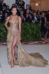 Irina Shayk walking the red carpet at The Metropolitan Museum of Art Costume Institute Benefit celebrating the opening of Heavenly Bodies : Fashion and the Catholic Imagination held at The Metropolitan Museum of Art  in New York, NY, on May 7, 2018. (Photo by Anthony Behar/Sipa USA)