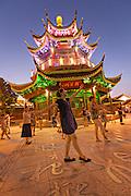Women perform dance exercise at a pagoda along Shantang canal in Suzhou, China.
