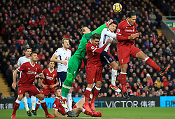 Liverpool's Virgil van Dijk (right) jumps for a header during the Premier League match at Anfield, Liverpool.