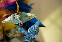 Hand made arigami birds made by members of the Congregational Church of Laconia hang as a mobile at Temple B'nai Israel to express their support, encouragement and hope. (Karen Bobotas/for the Laconia Daily Sun)