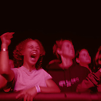 USA, Washington, Seattle, Concert fans listen to Ani DiFranco perform at Memorial Stadium at Bumbershoot Festival