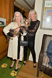 Left to right, MAUREEN FREEMANTLE, her dog Kevin, VICTORIA ASHER and her dog Betty at A Date With Your Dog At George in aid of the Dogs Trust held at George, 87-88 Mount Street, London on 9th September 2014.