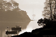 Early morning mist over the Menai Strait from the Cadnant bridge, Menai Bridge.<br />