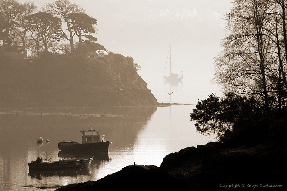 Early morning mist over the Menai Strait from the Cadnant bridge, Menai Bridge.<br /> <br /> Available as unlimited A3 & A4 prints