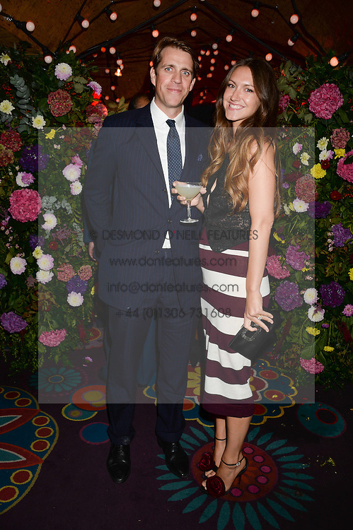 BEN ELLIOT and his wife MARY CLARE ELLIOT at a 1970's themed party as part of Annabel's 50th anniversary celebrations, held at Annabel's, Berkeley Square, London on 24th September 2013.