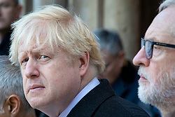 © Licensed to London News Pictures. 02/12/2019. London, UK. Prime Minister Boris Johnson (L) stands alongside Labour Party Leader Jeremy Corbyn (R) at a vigil at Guildhall Yard following a terrorist attack on London Bridge in which two people were killed. The attacker was shot by police firearms officers and pronounced dead at the scene. Photo credit: Rob Pinney/LNP