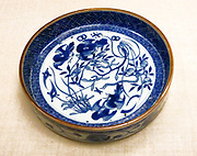 Dish - porcelain with decoration in underglaze blue.  Birds and plants with geometric border. Chinese : Jingdezhen kilns (Shonzui type) circa 1620-1640.
