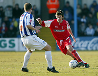 Photo: Chris Ratcliffe.<br />Colchester United v Swindon Town. Coca Cola League 1. 18/03/2006.<br />Pat Baldwin (L) of Colchester closes down Gareth Whalley of Swindon