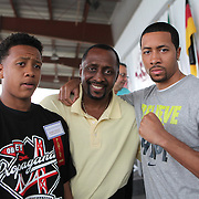 "Inductee Thomas ""Hitman"" Hearns poses with family members during the 23rd Annual International Boxing Hall of Fame Induction ceremony at the International Boxing Hall of Fame on Sunday, June 10, 2012 in Canastota, NY. (AP Photo/Alex Menendez)"