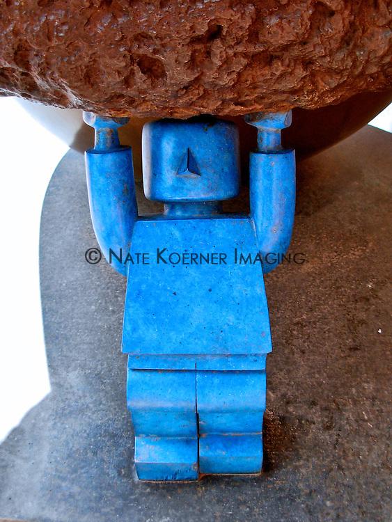 Blue Robot Holding Rock