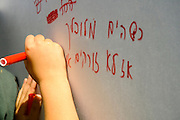 Israel, Caesarea, Children activity to promote clean seas and oceans Organised by the Green Net foundation May 6 2009 Children writing ecological slogans on a white board