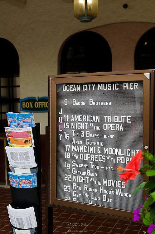 The schedule for the Ocean City Music Pier's July performances sits in front of the box office with various other pieces of information about the venue.