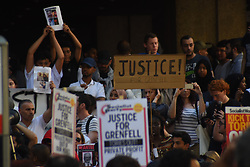 June 16, 2017 - Kensington, England, United Kingdom - A protest takes place at Kensington and Chelsea Town Hall, following the fire of the Grenfell Tower block, London on June 16, 2017. Protesters gathered outside Kensington and Chelsea Town Hall, to demand justice for those affected by the fire that gutted Grenfell Tower. Emergency workers continued searching for bodies, warning they may never be able to identify some of the victims. (Credit Image: © Alberto Pezzali/NurPhoto via ZUMA Press)