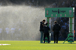 8 April 2017 - Premier League - West Bromwich Albion v Southampton - Premier League staff try to erect a hoarding as the sprinklers come on - Photo: Paul Roberts / Offside
