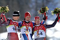 Photo: Catrine Gapper.<br /> Winter Olympics, Turin 2006. Alpine Skiing Downhill. 12/02/2006.<br /> Michelle Walchhoffer (Austrian silver medalist), Antoine Deneriaz (France Gold medalist) and Bruno Kernen (Switwerland's Bronze medalist) celebrate their victory.