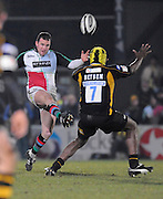 Wycombe, GREAT BRITAIN,  Quins' Chris MALONE Chips Serge BETSEN, during the the  London Wasps vs Harlequins rugby match at Adam's Park Stadium, Bucks on Sun 04.01.2009. [Photo, Peter Spurrier/Intersport-images]
