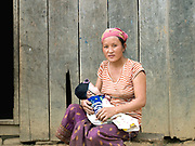Portrait of a Hmong ethnic minority woman and her young baby in the village of Ban Tatong, Phongsaly, Laos