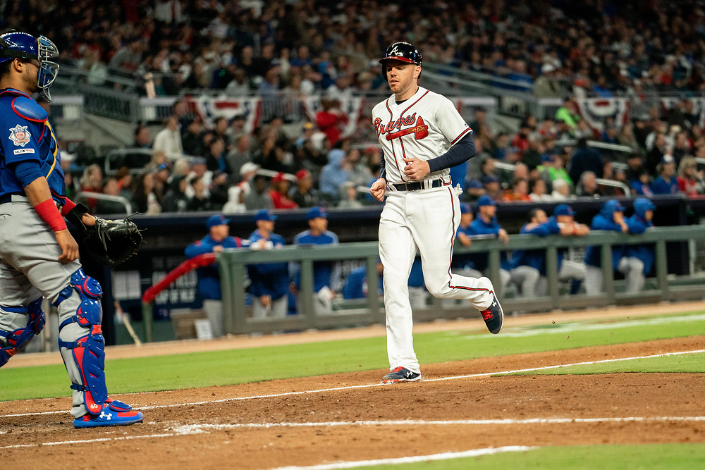 Freddie Freeman scores during the home opener against the Chicago Cubs on Monday, April 1, 2019. The Braves won 8-0. Photo by Kevin D. Liles/Atlanta Braves