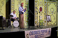 A member of the George Formby Appreciation Society playing to the annual gathering in Blackpool playing his ukulele to the audience at the town's Winter Gardens. The society was formed in 1961 and holds an annual event to celebrate the life of the famous Lancastrian singer and entertainer.