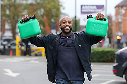 © Licensed to London News Pictures. 25/09/2021. London, UK. A man arrives at Sainsbury's petrol station in north London with two petrol cans as drivers continue to panic buy petrol amid a fuel shortage fear arising from a shortage of HGV drivers. Photo credit: Dinendra Haria/LNP