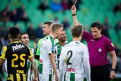 (L-R) Kasper Larsen of FC Groningen, referee Jeroen Manschot during the Dutch Eredivisie match between FC Groningen and Vitesse Arnhem at Noordlease stadium on November 19, 2017 in Groningen, The Netherlands