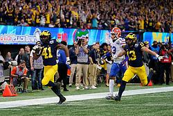 Michigan Wolverines running back Christian Turner #41 runs the ball during the Chick-fil-A Peach Bowl, Saturday, December 29, 2018, in Atlanta. ( Paul Abell via Abell Images for Chick-fil-A Peach Bowl)