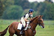 Rider Pippa Funnell  in the cross-country phase of an eventing competition, Charlton Park, Wiltshire, United Kingdom