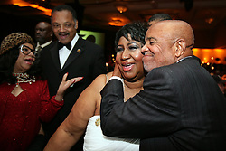 Aretha Franklin Died at 76 on August 16, 2018 - Berry Gordy hugs Aretha Franklin while Jesse Jackson and a guest looks on at the Motown 50 Golden Gala Live it Again Weekend at the Marriott in the Renaissance Center in Detroit, Mich., on Saturday, November 21, 2009. Photo by Kimberly P. Mitchell/Detroit Free Press/TNS/ABACAPRESS.COM