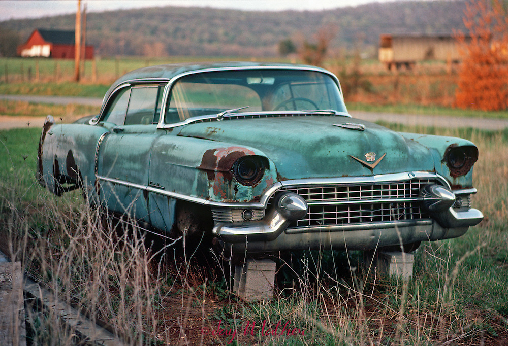A Cadillac on cinder blocks in a rural area of southeast Kentucky.