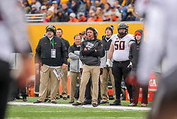 Nov 23, 2019; Morgantown, WV, USA; Oklahoma State Cowboys head coach Mike Gundy watches from the sidelines during the second quarter against the West Virginia Mountaineers at Mountaineer Field at Milan Puskar Stadium. Mandatory Credit: Ben Queen-USA TODAY Sports