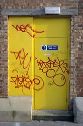 Graffiti on yellow door UK