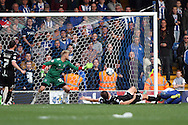 Grant Holt of Wigan Athletic lies on the floor as he scores his teams 1st goal.  Skybet football league one match , Bury v Wigan Athletic at the JD Stadium in Bury, Lancs on Saturday 10th October 2015.<br /> pic by Chris Stading, Andrew Orchard sports photography.