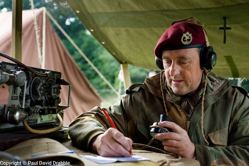 Re-enactor portrays a radio operator of the 22nd Independent Parachute  Note the cap badge is Army Air Corps with kings crown and eagle facing right and not the usual Kings Crown Parachute Regiment Cap Badge which the company would have worn later in the war. Norfolk Heritage Park Sheffield 29th and 30th Aug 2010 .Images © Paul David Drabble..