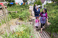 20140601 Free for editorial use image<br /> <br /> Halifax colleagues in Bournemouth are proud to give extra back to their local community by hosting their Big Lunch event on Sunday 01 June 2014.<br /> <br /> Members of the public arrive for The Big Lunch at the New Leaf Allotment in Bournemouth. <br /> <br /> For more information please contact: Catherine Eastham on 020 3697 4304<br /> <br /> If you require a higher resolution image or you have any other onEdition photographic enquiries, please contact onEdition on 0845 900 2 900 or email info@onEdition.com<br /> This image is copyright the onEdition 2014©.<br /> This image has been supplied by onEdition and must be credited onEdition. The author is asserting his full Moral rights in relation to the publication of this image. Rights for onward transmission of any image or file is not granted or implied. Changing or deleting Copyright information is illegal as specified in the Copyright, Design and Patents Act 1988. If you are in any way unsure of your right to publish this image please contact onEdition on 0845 900 2 900 or email info@onEdition.com